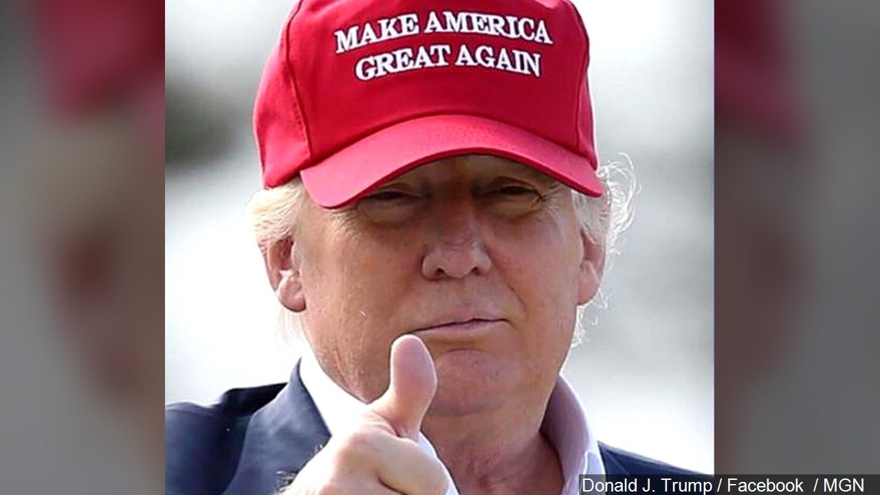 "Donald Trump gives a ""thumbs up"" in his Make America Great Again hat."