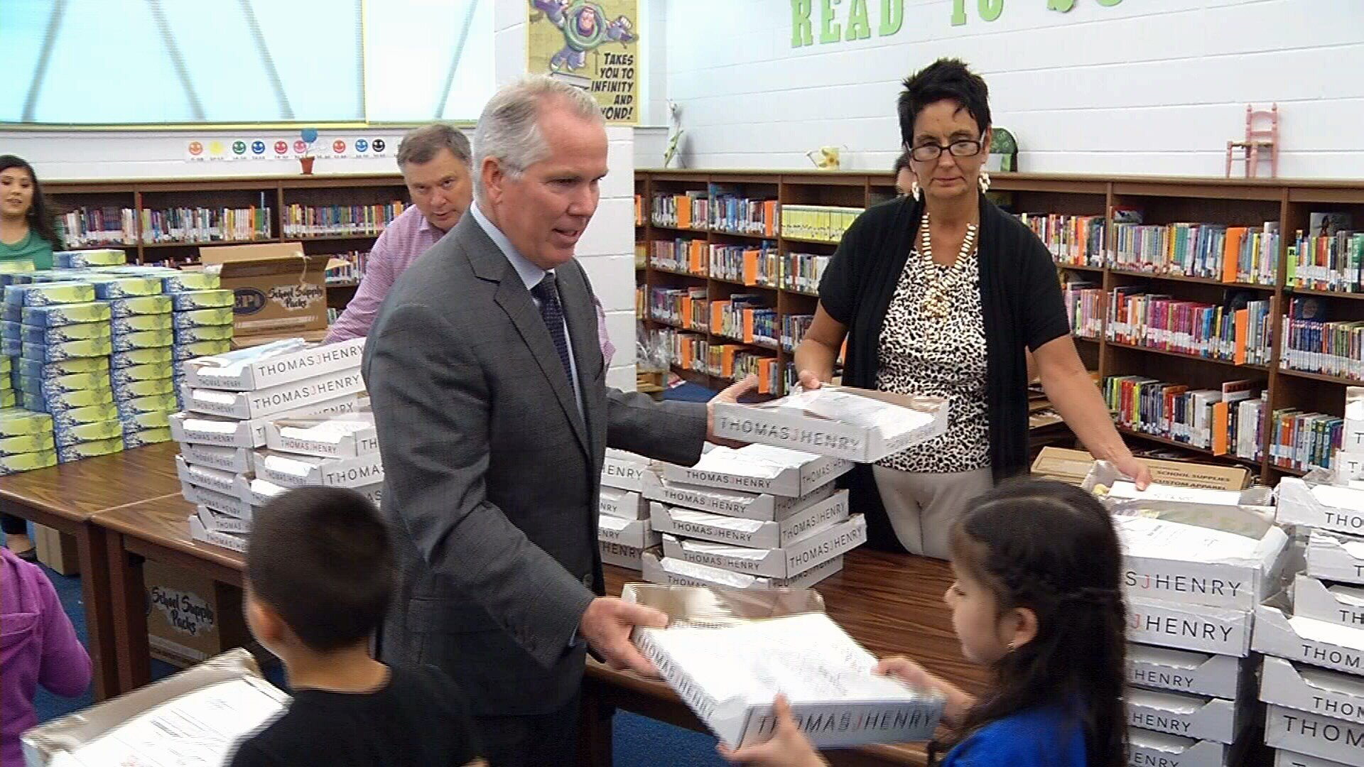 Attorney Thomas J. Henry passing out supplies at J.A. Garcia Elementary.