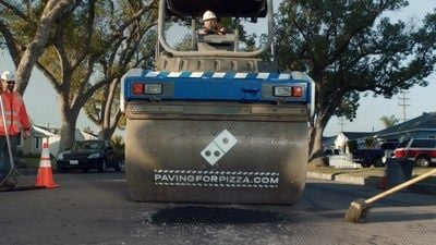 Domino's kicks off pavement project.  Photo from Domino's website.