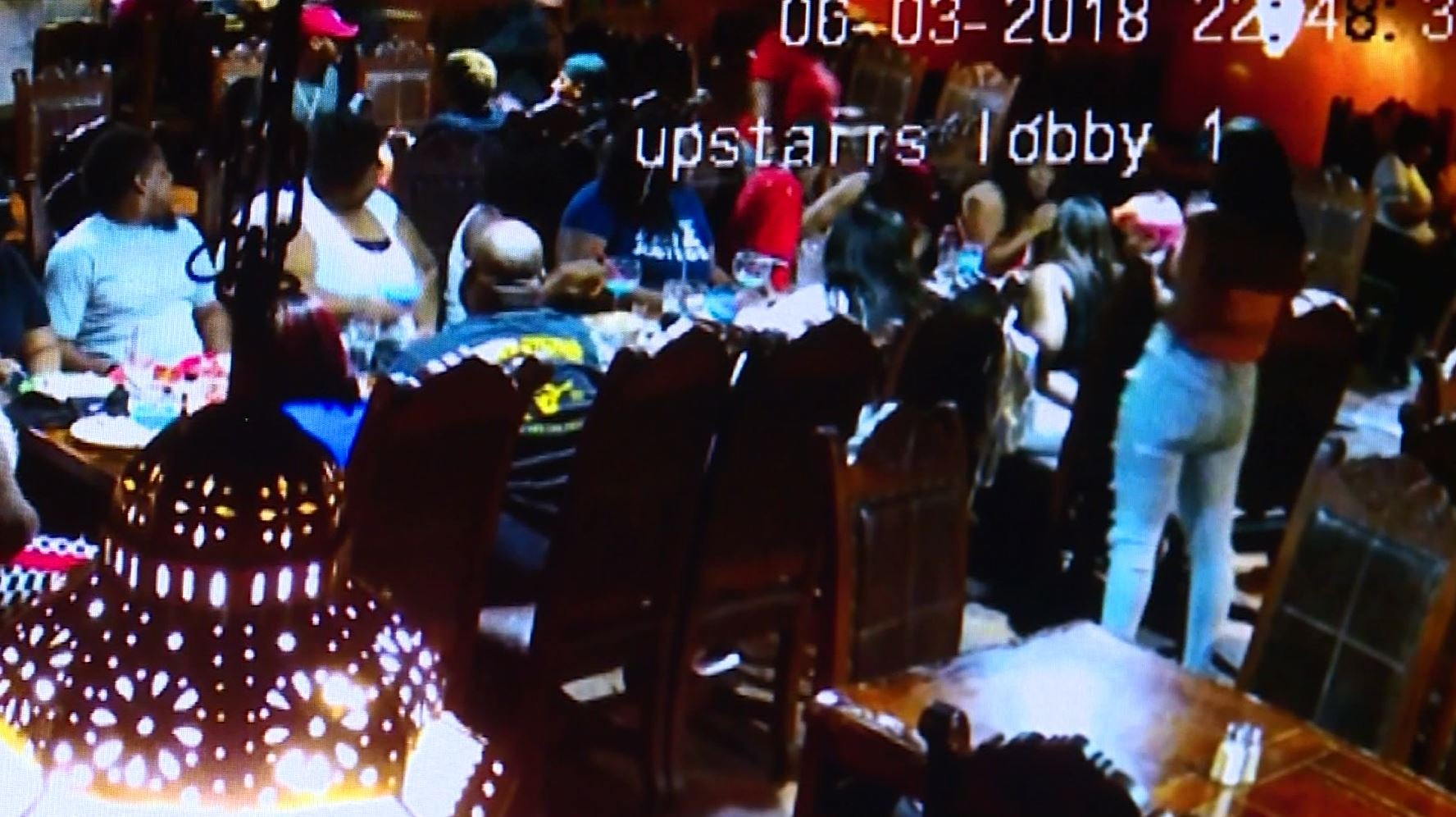 Image of surveillance video of teens eating before they left without paying.