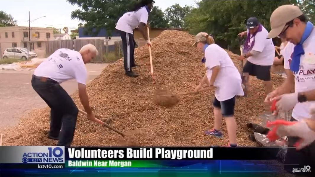Volunteers build a new playground for Promesa Charter School