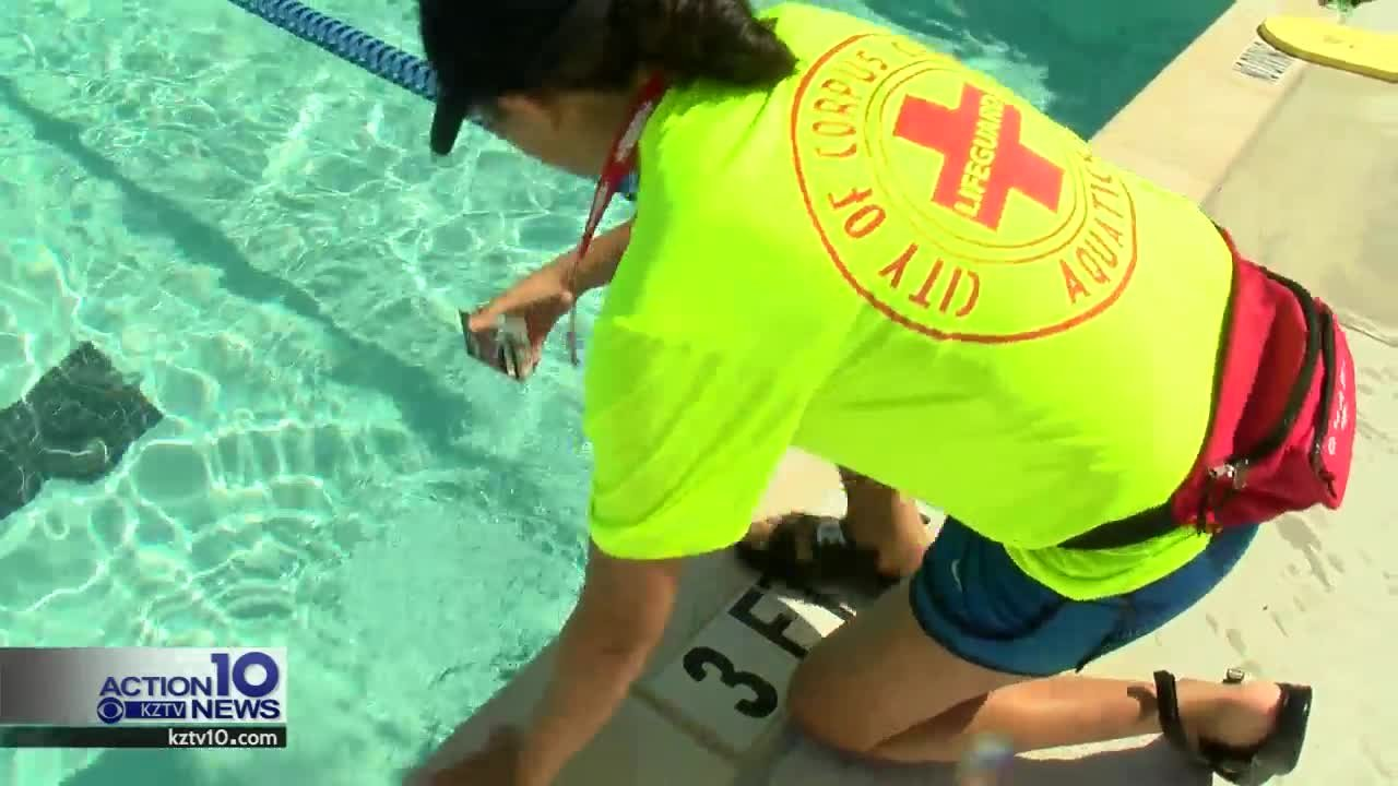 Lifeguards test the pool chlorine and Ph levels.