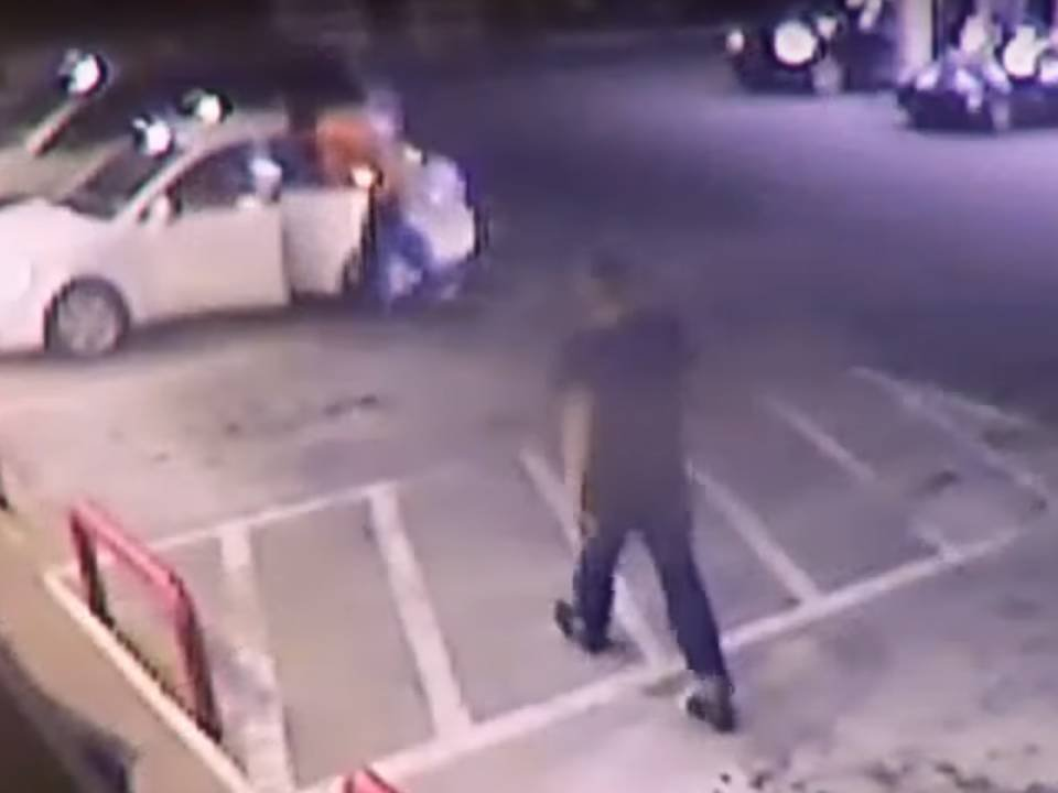 Surveillance video allegedly shows Cunha walking up to Naranjo in parking lot.